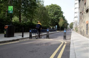 Goldsmiths Row in Hackney, one cited example of a quietway. Through motor traffic is blocked by bollards.