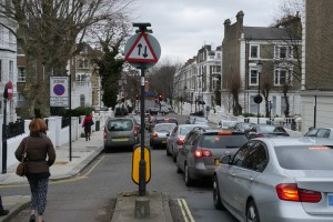 ...the second you reach Kensington and Chelsea the lane stops and it's up to you to 'negotiate' to the right of a queue of cars turning left. Why?